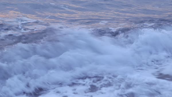 Close-up shot of waves breaking on a coast Rights-managed stock video