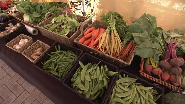 Medium shot of vegetables at a market Rights-managed stock video