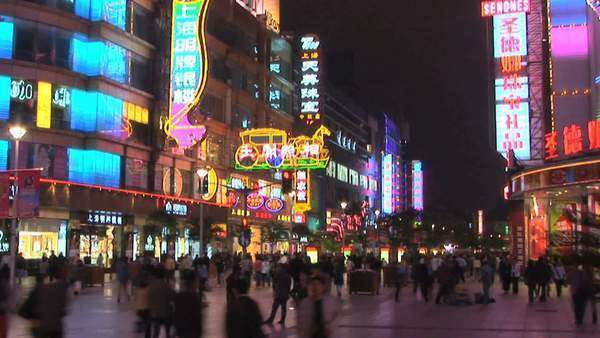 Neon lights on Nanjing Road, pedestrian mall, Shanghai, China, timelapse Royalty-free stock video