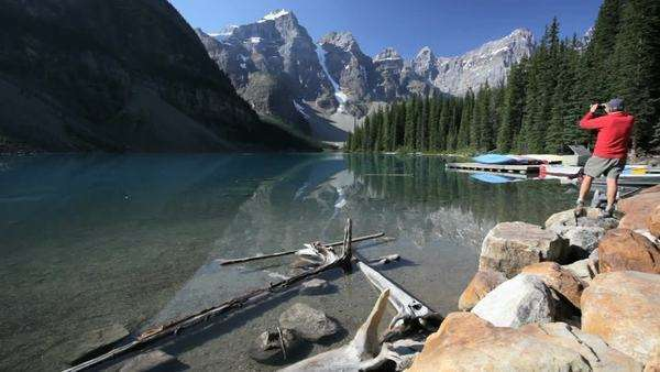 Man at Moraine Lake, Banff National Park, Canada Royalty-free stock video