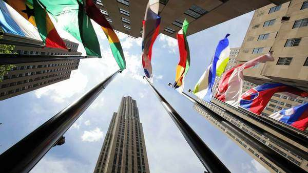 Flags of the world in New York City Rockefeller Plaza Royalty-free stock video