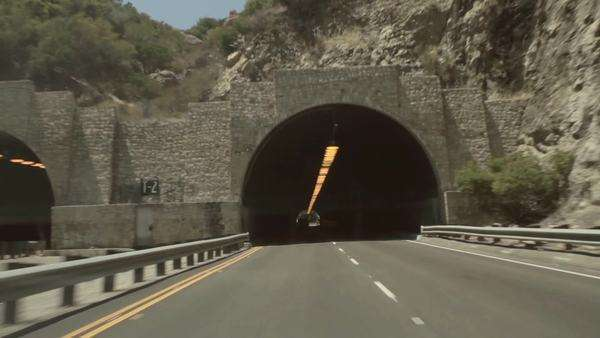 Wide shot of driving through a tunnel Royalty-free stock video