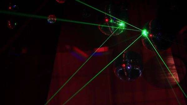 Green Laser on disco three disco balls in nightclub Royalty-free stock video