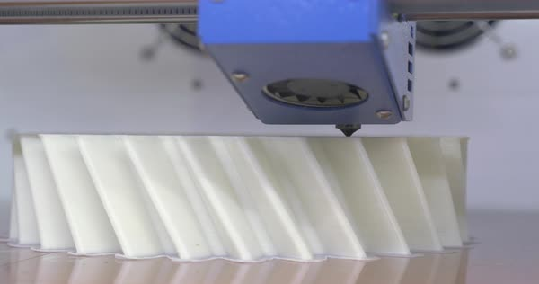Close-up shot of 3D printer head working and making an object from white plastic filament Royalty-free stock video
