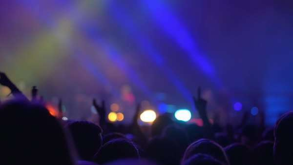 Slow motion shot of people claping their hands on the night pop concert, the stage in blue, in the end fade out comes Royalty-free stock video