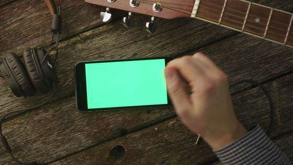 Musician using phone in landscape mode at home, top view. Royalty-free stock video