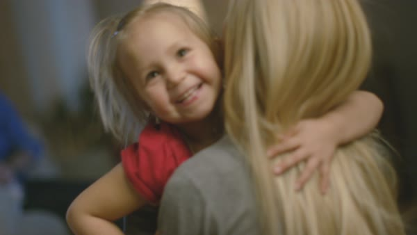 Cute daughter runs toward her mother and they hug. Royalty-free stock video