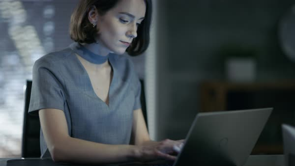 Stylish female top manager works on a laptop in her private office Royalty-free stock video