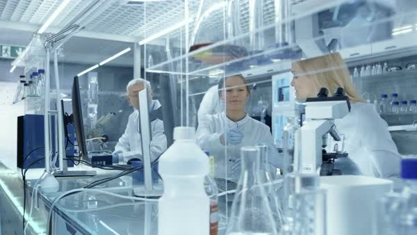 Following shot of a big laboratory / medical center where scientists conduct research/ experiments Royalty-free stock video