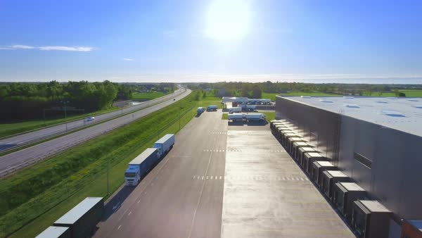 Aerial view footage of loading warehouse with semi trucks parked and waiting for loading Royalty-free stock video