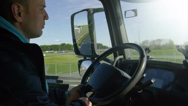 Inside of cabin view of the professional truck driver driving his big vehicle on the road Royalty-free stock video