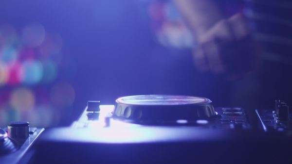 Dj mixing tracks in nightclub Royalty-free stock video