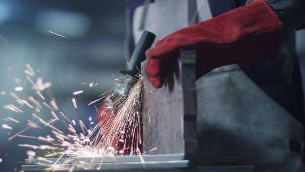 Worker using angle grinder in factory Royalty-free stock video