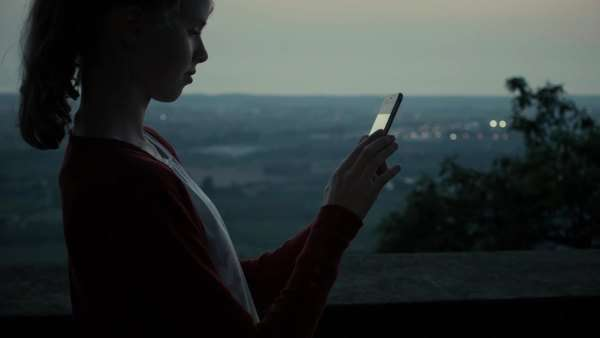 Girl is using mobile phone outdoors at evening Royalty-free stock video
