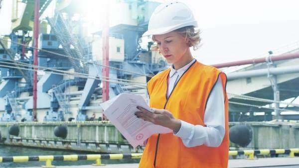 Woman in hard hat and safety vest in industrial environment Royalty-free stock video