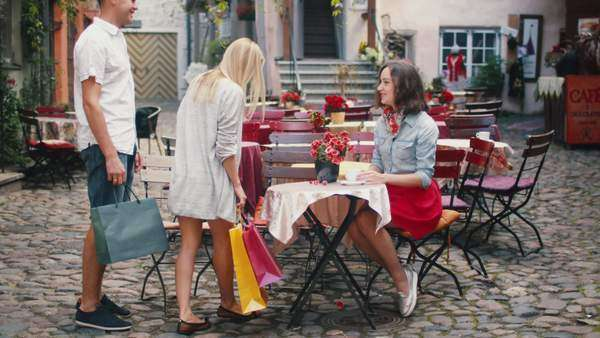 Girl is meeting friends in outdoor coffee shop Royalty-free stock video
