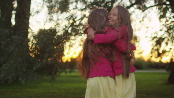 Two sisters are hugging each other outdoors Royalty-free stock video
