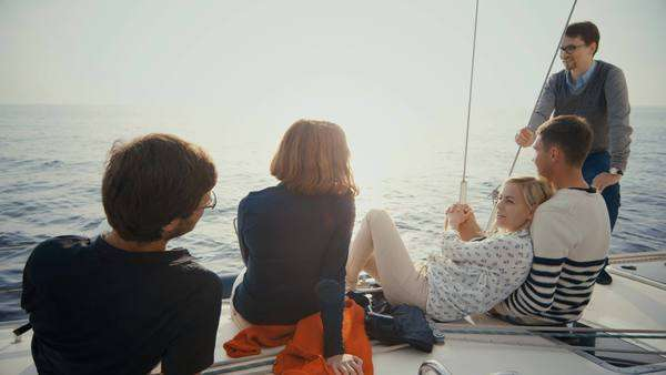 Group of people relaxing on a yacht in the sea. Royalty-free stock video