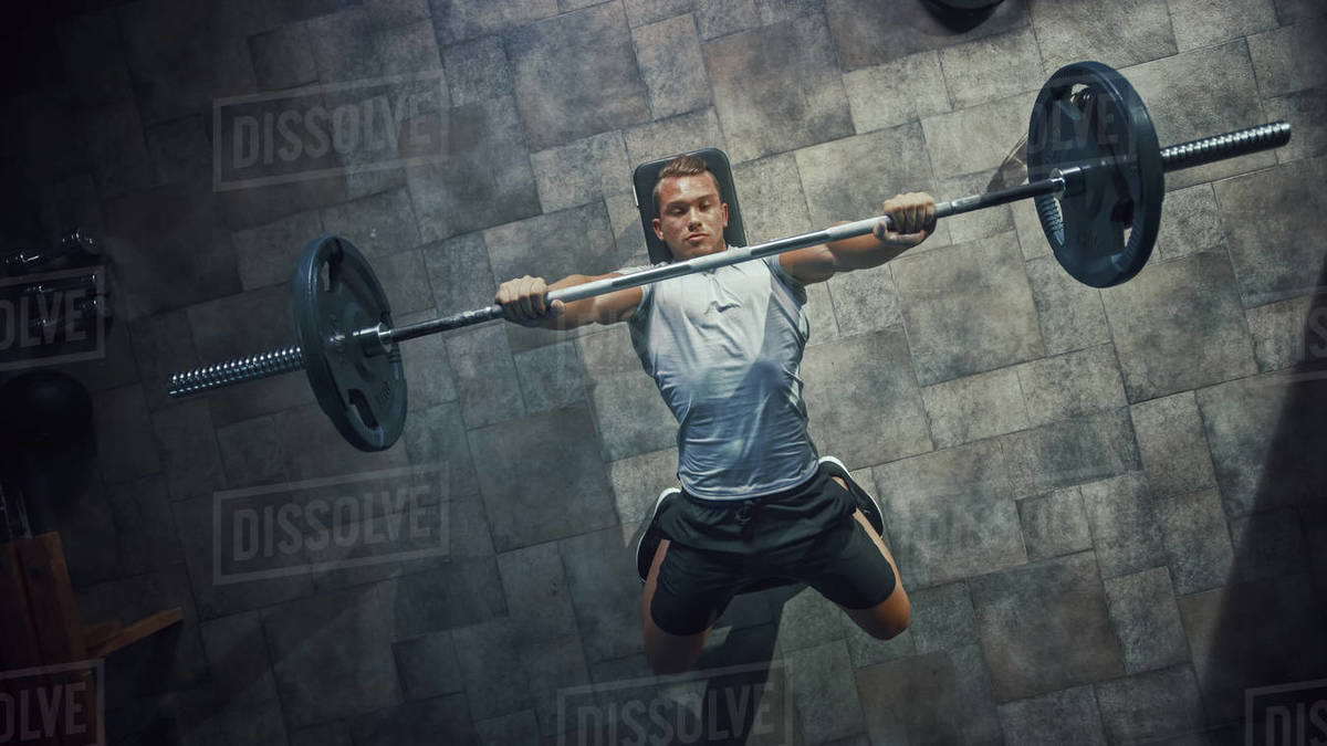 Top View of Professional Athlete Doing Bench Press Workout with a Barbell in the Hardcore Gym. Muscular and Athletic Bodybuilder Doing Barbell Exercise. Royalty-free stock photo