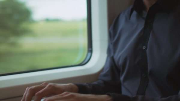 Man working on laptop in during traveling on train Royalty-free stock video