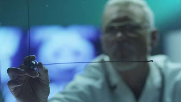 Scientist is drawing charts with marker on glass. Royalty-free stock video