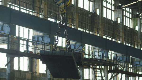 Industrial electromagnet crane during lifting and moving metal bars Royalty-free stock video