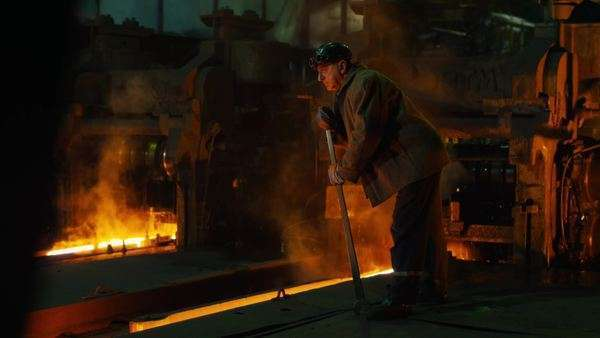 Heavy industry worker doing quality control in foundry. wide shot. Royalty-free stock video
