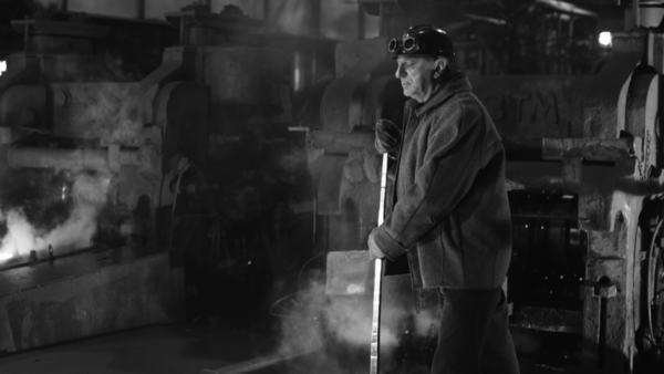 Heavy industry worker is working on foundry. wide shot. black and white. Royalty-free stock video