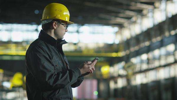 Technician in hard hat in using phone in Royalty-free stock video