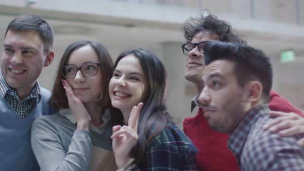 Group of young multi-ethnic students are making selfie pictures in a college. Royalty-free stock video