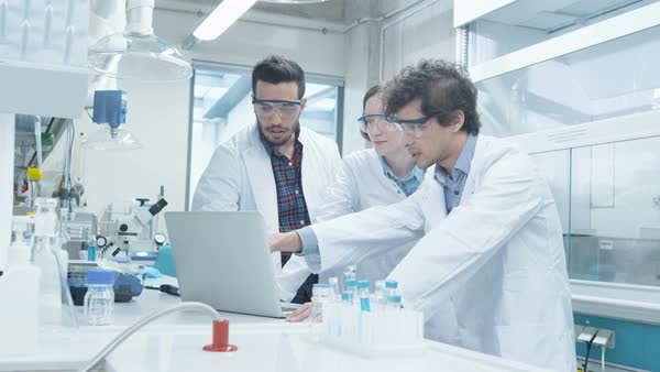 Group of students in coats using laptop in laboratory of chemistry classroom Royalty-free stock video