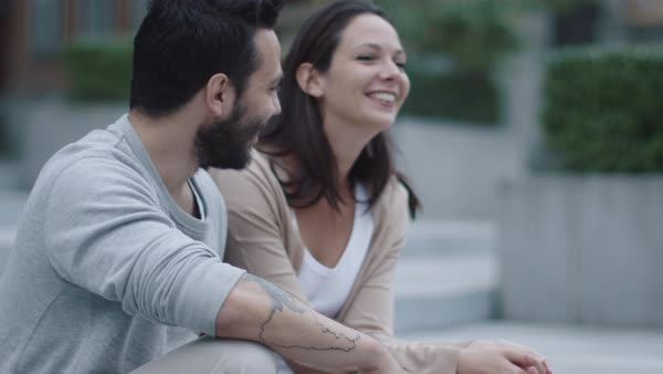 Young happy smiling man and woman talking outdoors. Royalty-free stock video