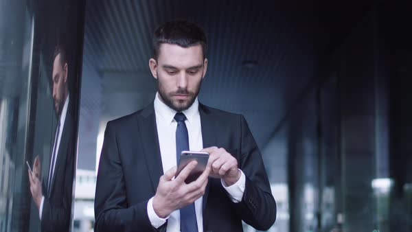 Businessman using mobile phone outdoors Royalty-free stock video