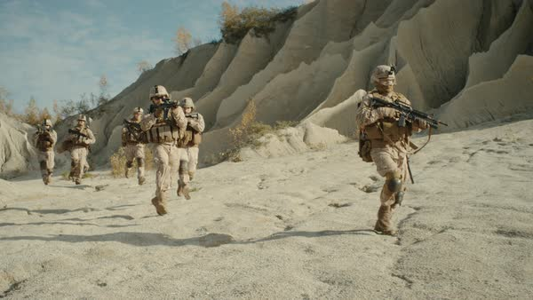Squad of Fully Equipped, Armed Soldiers Running in the Desert. Royalty-free stock video
