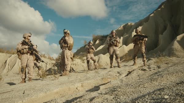 Squad of Fully Equipped and Armed Soldiers Standing in the Desert. Royalty-free stock video