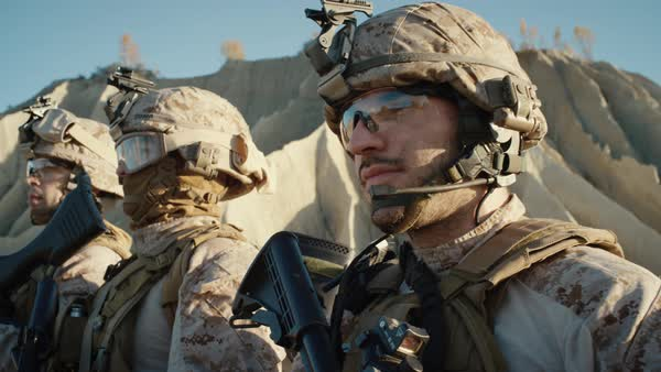 Close-up Shot Group of Fully Equipped Soldiers Standing in a Line in the Desert. Royalty-free stock video