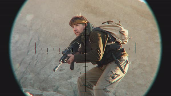 Looking at Crouching Insurgent through Sniper Scope Royalty-free stock video