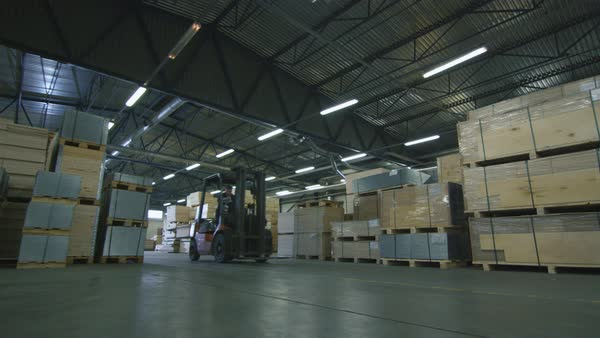 Forklift driving through the warehouse filled with wood Royalty-free stock video