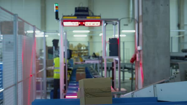 Parcels are moving on belt conveyor at post sorting office. box pov. Royalty-free stock video