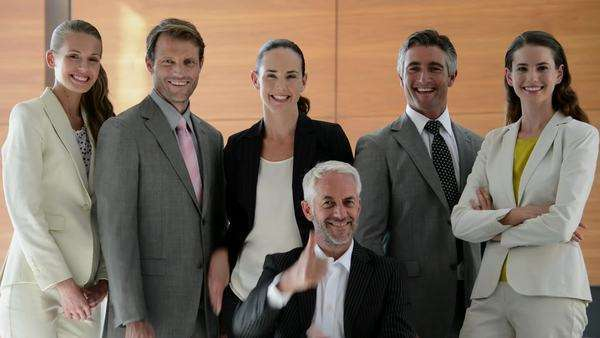 Business team of six people turning head to face camera then smiling and gesturing thumbs up. Royalty-free stock video