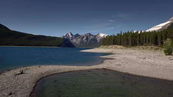 Aerial shot of a lake at the Spray Lakes Reservoir, Alberta Royalty-free stock video
