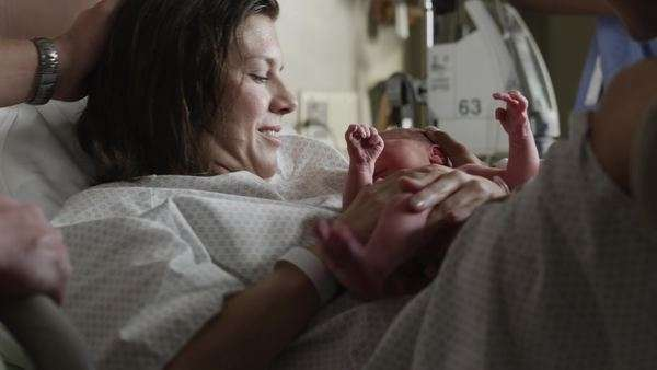 Medium shot mother holding newborn baby (0-1 months) in hospital / Payson, Utah, USA Rights-managed stock video