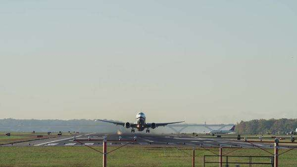 Wide low angle shot of airplane taking off from runway Royalty-free stock video