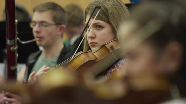 Close up of teenage girl playing violin in orchestra practice Royalty-free stock video