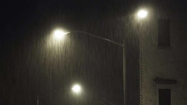 MS Illuminated street light in rain at night, New York City, New York Royalty-free stock video