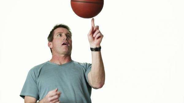 Medium shot of man spinning basketball, against white background Royalty-free stock video