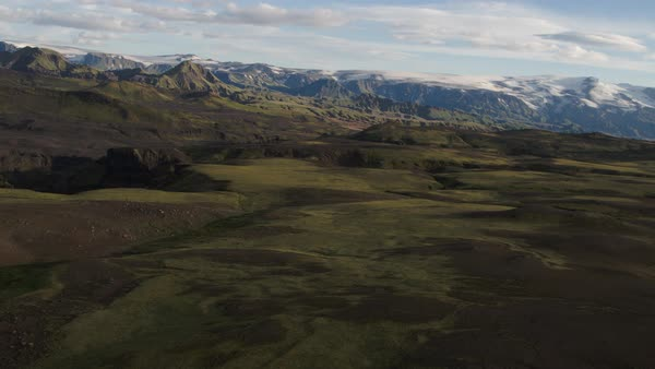 Wide high angle panning shot of canyon near mountain range Rights-managed stock video