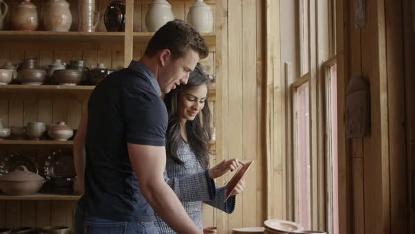 Medium shot of couple shopping in pottery store Royalty-free stock video