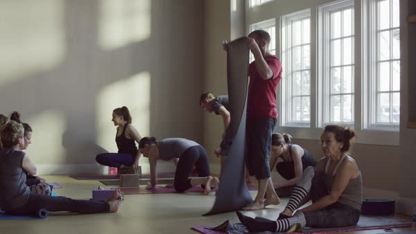 Medium slow motion panning shot of yoga class ending Royalty-free stock video