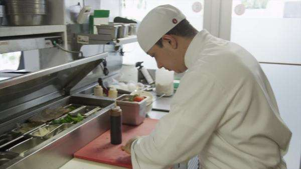 Medium shot Chef preparing salad in commercial kitchen, Miami, Florida Royalty-free stock video